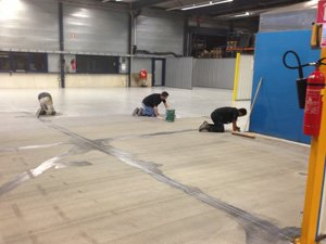 Coated floors for metalworking