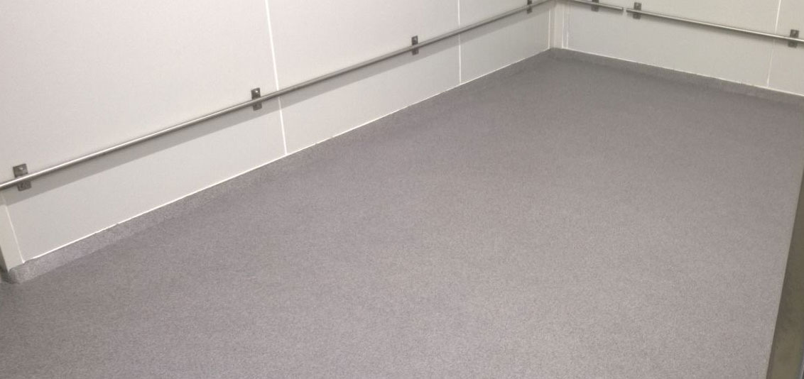 coated floor with continuous skirting board coating
