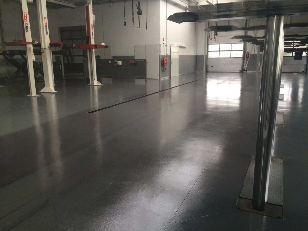 Coated floor car garage