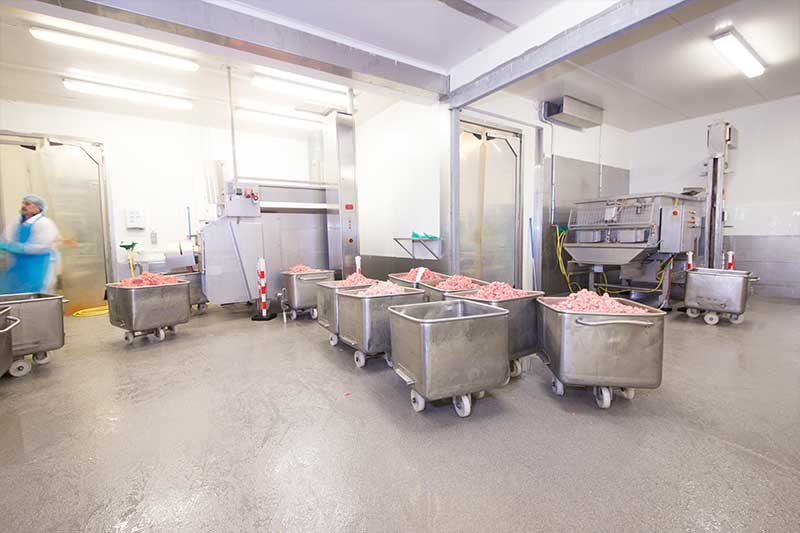 Coated floor meat processing plant